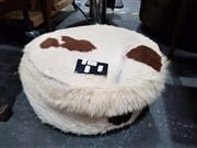 Sale 8676 - Lot 1023 - Cow Hide Stool