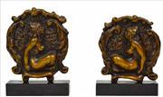 Sale 8325 - Lot 542 - Norman Lindsay (1878 - 1969) - Pair of Bookends, c1930 20.5 (h) x 14.5 (w) x 5.0cm (d)