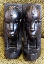 Sale 8320 - Lot 908 - 1970 Pair of Masai carved ebony bookends