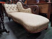 Sale 8814 - Lot 1049 - Late 19th Century Carved Cedar Chaise Lounge, the scrolled back upholstered in buttoned cream fabric & raised on turned legs