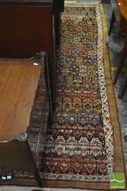 Sale 8335 - Lot 1030 - Antique Persian Wool Runner, identified as Kurdish on a tag,  with repeating flowers, within a floral and plain coffee coloured bord...