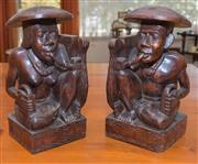 Sale 8368A - Lot 91 - A pair of carved timber Indonesian bookends of a couple smoking pipes, H 32cm