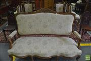 Sale 8335 - Lot 1078 - Well Carved Louis XV Style Carved Walnut & Gilt Salon Suite, comprising settee, armchair & ten side chairs, upholstered in cream flo...