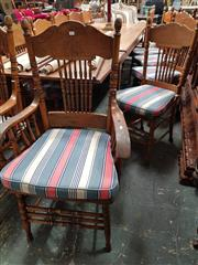 Sale 8868 - Lot 1028 - Set of 10 Late Victorian / Edwardian Elm Pressed Back Spindle Dining Chairs, including two armchairs, with caned seats and striped fa..