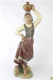 Sale 8630 - Lot 14 - A Lladro Returning From The Well Figure By Jose Luis Alvarez