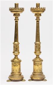 Sale 8651A - Lot 42 - Pair of Antique brasswork decorative candlesticks with ecclesiastical overtones, each height 45cm