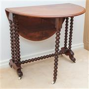 Sale 8908H - Lot 73 - An antique English mahogany sutherland table C.1870, the twin flap sides raised on bobbin turned gate legs. The centre supports of f...