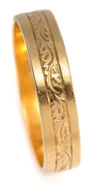 Sale 9095 - Lot 304 - AN 18CT GOLD BAND; 4.95mm wide band with engraved detail, size U, wt. 4.70g.