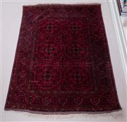Sale 9005H - Lot 95 - An Afghan Khal Mohamadi hand knotted carpet with geometric panels on a claret ground, 100cm x 137cm