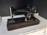 Sale 9051 - Lot 1064 - Vintage Singer Sewing Machine On Timber Base (H31cm)