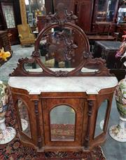 Sale 8939 - Lot 1076 - Victorian Burr Walnut Credenza, with carved mirror back, white marble top and three arched mirror panel doors flanked by columns. H:...