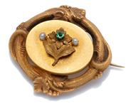 Sale 9037 - Lot 379 - A VICTORIAN 18CT GOLD BROOCH; central oval plaque applied with a flower set with a green stone and 2 freshwater pearls to a textured...
