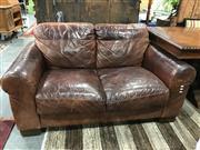 Sale 8787 - Lot 1089 - Sofitalia International Two Seater Leather Sofa