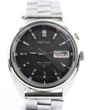 Sale 8829 - Lot 372 - A VINTAGE SEIKO BELL-MATIC AUTOMATIC WRISTWATCH; ref. 4006-6011 in stainless steel, charcoal dial, center seconds, day date, 17 jewe...