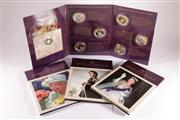 Sale 9035M - Lot 866 - Four sets of Macquarie Mint Queen Elizabeth II Coin Collections, one containing a 14ct Gold 2017 commemorative coin, 23 x 24ct gold...