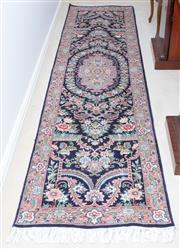 Sale 8341A - Lot 17 - A hand knotted Persian Pak Kashan runner with floral motifs with central medallion and dark blue border, 300 x 77cm