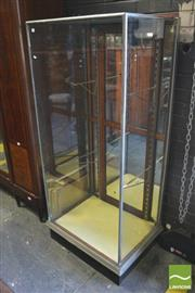 Sale 8390 - Lot 1080 - An Early 20th Century Chrome Plated Shop Vitrine with mirrored panel door