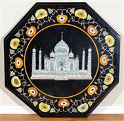 Sale 8562A - Lot 38 - A pietra dura and mother of pearl marble hexagonal table top, depicting the Taj Mahal with a decorative floral boarder, 90 x 90cm