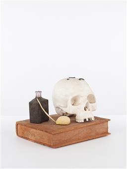 Sale 9221JM - Lot 5031 - DALE MILES Untitled (Vanitas) ceramic, timber, glass bottle and clay sculpture h.24, l. 28, d.22 cm signed