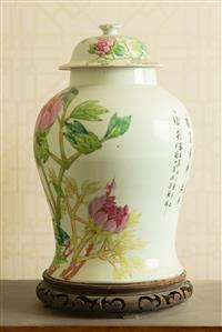 Sale 8392H - Lot 61 - A Cantonese baluster vase and lid on timber base depicting peonies and calligraphy, H 45cm