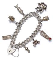 Sale 9012 - Lot 390 - A SILVER CHARM BRACELET; 8mm wide curb link chain to an heart shape padlock clasp and safety chain, attached with 8 silver and metal...