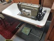 Sale 8676 - Lot 1343 - Industrial Singer Sewing Machine Table