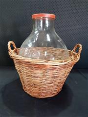 Sale 8979 - Lot 1039 - Glass Bottle in Basket (h:50cm)