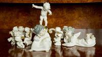 Sale 8392H - Lot 63 - A Hutschenreuther cherub candelabrum and associated musical cherubs, and a pair of Lladro cherubs