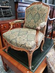 Sale 8814 - Lot 1022 - Generous Louis XV Style Carved Walnut Armchair, upholstered in green & cream diaper pattern with floral panels, raised on cabriole legs