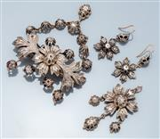Sale 9037F - Lot 43 - A VINTAGE VICTORIAN STYLE SILVER AND DIAMOND FLORAL DEMI PARURE; brooch 65 x 84mm, pendant 58 x 26mm, and earrings 39 x 19mm on shep...