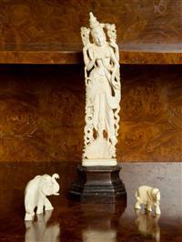Sale 8392H - Lot 64 - An Indian bone figure of a deity, H 22cm, together with miniature elephants