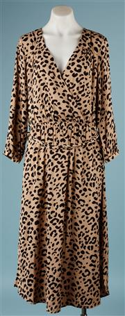 Sale 9090F - Lot 100 - A WITCHERY WRAP DRESS; in leopard print, tie front and long sleeves, size 12