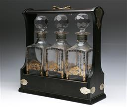 Sale 9093 - Lot 97 - Timber Tantalus with Silver Plated Mounts with Three Large Decanters with Gilded Print