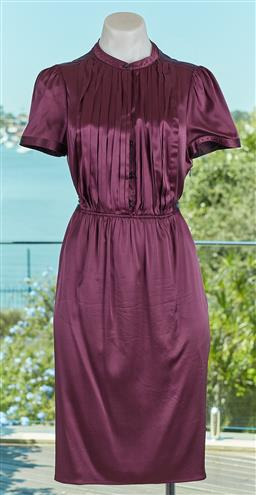 Sale 9120K - Lot 5 - A Burberry mulberry 94% silk dress; with concealed zipper to side, size UK 10