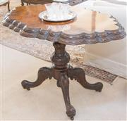 Sale 8341A - Lot 72 - A Victorian Irish center table in superbly figured walnut, carved center column on quadruped base, H 70 x W 107 x D 72cm