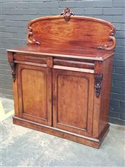 Sale 9048 - Lot 1043 - Early Victorian Mahogany Chiffonier, with carved back, two cushion shaped drawers & two arched panel doors (H:150 W:120 D:46cm)