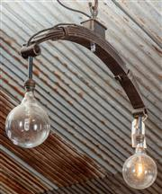 Sale 8984W - Lot 557 - A Wombat hollow manufactured ceiling light of crescent form with plug, purposed from automotive springs. Total height including chai...