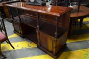 Sale 8500 - Lot 1092 - Unusual Victorian Carved Mahogany Breakfront Dumbwaiter, with fluted columns & two panels doors flanking an alcove (2 x Keys In Office)