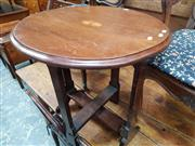 Sale 8814 - Lot 1059 - Early 20th century Mahogany Folding Table, the round top with bat-wing medallion to centre