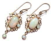 Sale 9037 - Lot 376 - A PAIR OF EDWARDIAN STYLE OPAL EARRINGS; 9ct gold scroll frames with fringe drops set with oval and round cabochon white opals, leng...