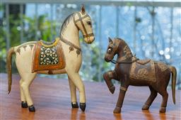 Sale 9164H - Lot 86 - A painted timber horse together with a smaller timber and metal adorned example, Height of taller 21cm