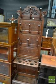Sale 8460 - Lot 1053 - Carved Oak Hallstand, with timber hooks & a shelf with umbrella & stick receptacles