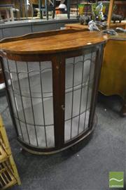 Sale 8386 - Lot 1097 - Demi Lune Cabinet with Leadlight Doors