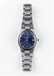 Sale 8770 - Lot 81 - An Omega Automatic Wristwatch; in stainless steel with blue sunburst dial, centre seconds, date, self wind movement cal. 1012, Omega...