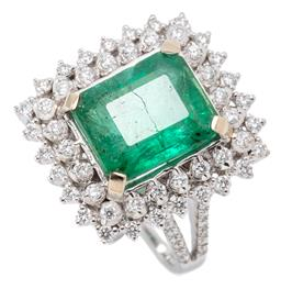Sale 9160 - Lot 385 - AN 18CT WHITE GOLD EMERALD AND DIAMOND COCKTAIL RING; featuring an emerald cut emerald of approx. 4.95ct (surface reaching fracture)...
