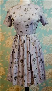 Sale 8448A - Lot 96 - Gorgeous 1950s Mode O Day California mauve floral day dress featuring calf length pleated skirt, fabric belt tie & metal zipper C...