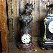 Sale 8795K - Lot 234 - A French rouge marble clock with spelter bust