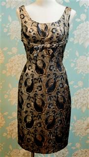 Sale 8448A - Lot 97 - Exquisite late 50s early 60s vintage black & gold patterned empire wiggle bombshell dress featuring beautiful gold lame threaded f...