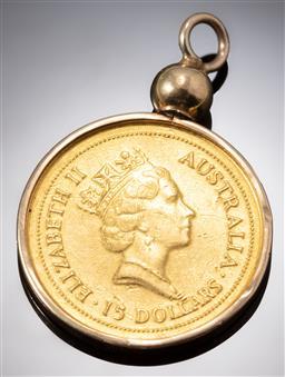 Sale 9153C - Lot 334 - AUSTRALIAN NUGGET $15 GOLD COIN PENDANT; 1/10oz 1994 fine gold coin set in a detachable 14ct gold frame, total wt. 3.53g.