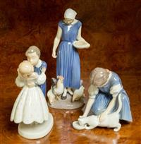 Sale 8392H - Lot 74 - Three Bing & Grondahl figural groups including; girl with chickens, girl with cat and courting couple.